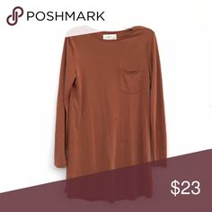 Pumpkin Faux Suede Dress Deep orange/brown suede-like dress, with one pocket on the front. Long sleeved. Small stains, as photographed. Reflected in price. Abercrombie & Fitch Dresses Long Sleeve