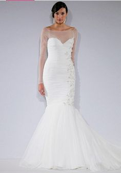 A Sheerly fabulous neckline on this Mark Zunino ball gown.