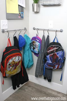 Hung at kid-height, this entryway solution inhibits floor clutter with a towel bar and hooks.