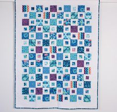 """Bring a big-city view indoors with the City Square Quilt Kit! You'll receive a pattern and Violette fabric to sew this modern, 54"""" x 72"""" quilt top. Featuring simple blocks and a stunning palette, this design is the perfect showcase for a beautiful assortment of Amy Butler prints."""