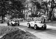 Donington Park, Great Britain, October 1938: Hermann Muller (Auto Union D-typ) leads Dick Seaman (Mercedes-Benz W154)