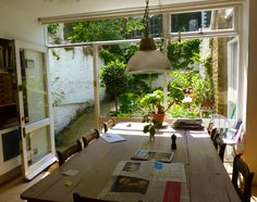 kitchen table with beautiful view of small back garden; sunny, airy, and functional