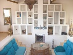 Sunken lounge with fireplace, built in storage