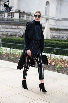 Olivia Palermo at Topshop Unique Fall 2016, February 21, 2016: pinstripe navy blouse, turtleneck sweater, coat, striped pants, ankle boots #LFW #AW16