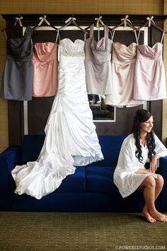Photo with the bride, her dress, and the bridesmaids' dresses.