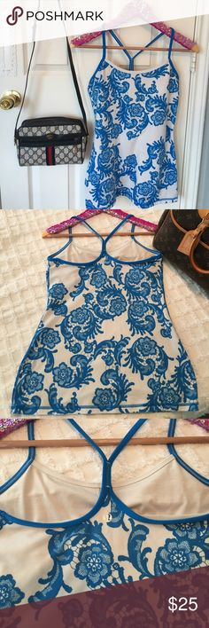 """Lululemon Blue Lace Print Top Size 8! Slight pilling, and back band is slightly stretched. No stains, rips, or runs. Chest measures 15"""" across, waist is 14.5"""" across, length is 25"""". Inner bra attached. lululemon athletica Tops Tank Tops"""