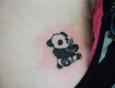 Cute Tiny Panda With Bamboo Tree Tattoo