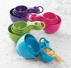 http://www.surlatable.com/product/PRO-190194/Sur-La-Table%26%23174%3B-Sets-of-Four-Measuring-Cups    Available in a fun assortment of colors, these measuring cups nest for easy storage. Durable, BPA-free melamine. 1 cup, ½ cup, 1/3 cup, ¼ cup.