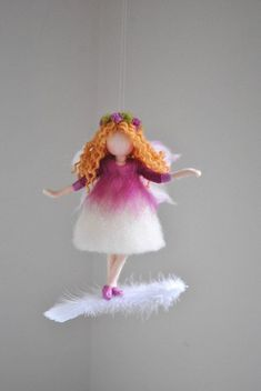 Purple fairy felted doll wool ornament: purple flower fairy on the feather - This is a Waldorf inspired piece made of wool using the needle felting technique. It is created to - Wool Dolls, Felt Dolls, Fairy Crafts, Felt Crafts, Ballerina Ornaments, Primitive Doll Patterns, Felt Fairy, Felt Angel, Felting Tutorials