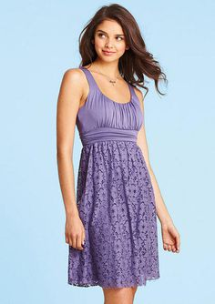 Sleeveless mixed-media knit to lace dress with shirred bodice.