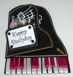 Laurel's Cleverly made Piano card using ribbons for keys