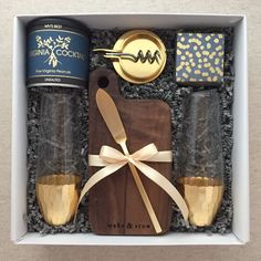 This gift is perfect for a client holiday gift or housewarming/closing gift! That Make & Stow cutting board is gorgeous styled with a gold cheese knife!!