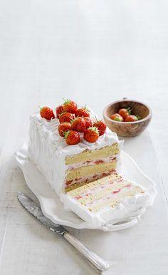 Strawberry cake: sponge cake layered with strawberry macarpone cream and italian meringue icing