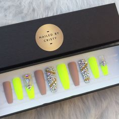 Matte Neon yellow and nude press on nails adorned with genuine Swarovski crystals & gold accents. Available in any shape & size.  Choose a 10 Nail set or a Full Set of 20 nails (All Sizes) if unsure of sizing. Sizes: XS, S, M, L  XS: THUMB 3, POINT 6, MIDDLE 5, RING 7, PINKY 9  S: THUMB 2, POINT 5, MIDDLE 4, RING 6, PINKY 9  M: THUMB 1, POINT 5, MIDDLE 4, RING 6, PINKY 8  L: THUMB 0, POINT 4, MIDDLE 3, RING 5, PINKY 7  FULL SET: You receive 20 nails size 0-9. With your order you will also…