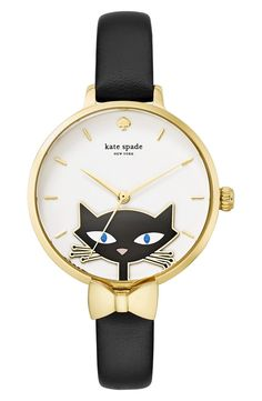 A curious kitty with sparkling eyes peers from the dial of this whimsical round watch set on a sophisticated slim leather band with gold details by Kate Spade.