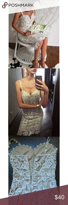Lace Bodycon Midi Dress Beautiful bodycon dress features overall lace in floral details, bustier neckline and spaghetti straps. Midi length. Fully lined. Back zipper. White color with nude color lining. Wild Bella Dresses Midi