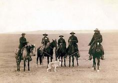 This picture shows a group of cowboys that have roped a Gray Wolf. The picture was taken in 1887 in Wyoming