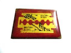 vintage JUDAS PRIEST metal enamel pin british steel razor blade