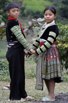 I put this in the Hmong children female clothes because her outfit is shown more.  i believe this is Strip Hmong.  This is from The Hmong People, Coity Simone.