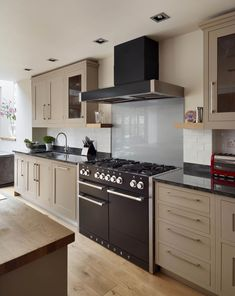 Hand painted in warm biscuit tones, this classic-style, framed kitchen has been paired with a stylish, black, range cooker Range Cooker Kitchen, Black Range Cooker, Black Cooker, Kitchen Paint, New Kitchen, Kitchen Cabinets, Kitchen Ideas, Kitchen Layout, Home Decor