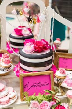 black and white stripe chic cake with pink and red flowers, French themed dessert table