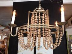 Stunning brass & wood bead chandelier from Gabby Home. $614.00.