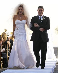 Angie Everhart and Carl Ferro married on December 6, 2014.