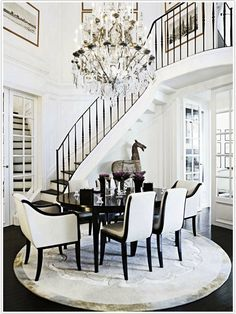 gorgeous small staircase  unusual location for dining, or unusual location for stairs?