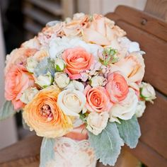 Vintage-looking bouquet of garden roses, ranunculus and stock in shades of peach, coral and white. LOVE!