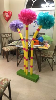 Truffula Trees to decorate my classroom for Dr. Suess' Birthday! Pool noodles and duct tape from Target. Fluffy tissue paper balls from Party City. Thin PVC pipe, scrap wood (free), and a sample of bold avocado green paint, from Home Depot! Grand total of about $20