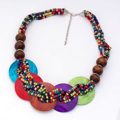 The Multi Color Beaded Disc Necklace. Five smooth, polished discs are fastened to multiple beaded strands with brown bead accents. This necklace puts on a color show displaying vibrant shades of green, blue, red, brown, and purple. DETAILS: http://www.lolafashionaccessories.com/products/Multi-Color-Beaded-Disc-Necklace.html #Necklace #Fashion #Baltimore #Jewelry #Vibrant #Beaded #Colorful #Purple #Green #Blue #Spring #Summer #Elegant #Style #Accessories #Red #Disc #LolaFashionAccessories