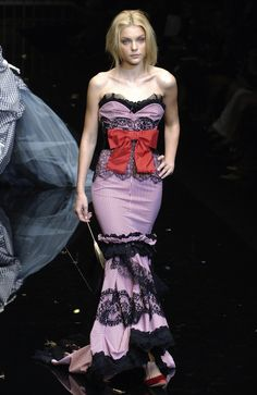 Dolce & Gabbana Spring 2006 – maybe I'm a fashion lame-o, but I'd totally love it without the big bow in front. But I like the sexy bordello feel of this dress.