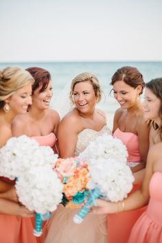 Coral bridesmaids dresses from David's Bridal. Wedding photos in Fort Walton Beach, Florida. Destination wedding in Fort Walton Beach.
