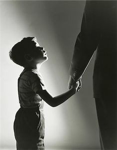 Side profile of a son holding his father's hand Stock Photo -  Rights-Managed,