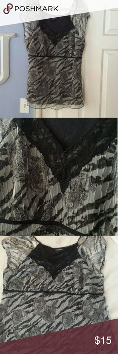 """Black and white blouse Cute cap sleeve blouse with lace detailing.  Blouse and lining both 100% Polyester 22/24 Worn only a few times Length 31"""" Lane Bryant Tops Blouses"""