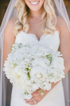 A lush white bouquet with peonies | @clanegessel | Brides.com