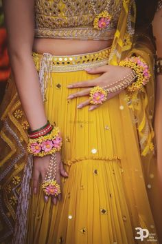 gorgeous yellow mirror work mehendi lehenga with pink yellow floral jewellery. Bridal Mehndi Dresses, Bridal Lehenga, Mehndi Dress For Bride, Mehndi Brides, Wedding Dresses, Flower Jewellery For Mehndi, Flower Jewelry, Flower Bracelet, Diamond Jewellery