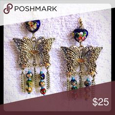 Flutter earrings Intricate beads on a detailed butterfly with thin chains.  Note: price reflects materials used and time it took me to make it! However, feel free to make an offer. Jewelry Earrings