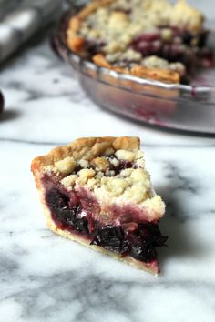Sweet Cherry Pie with Crumble Topping - This pies hidden ingredient is crystalized ginger in the crumble! Adds a touch of spice that keeps it from being too sweet. A Summertime favorite!