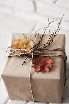 Decorate your gifts with a touch of autumn. Collect twigs, dried flowers and either press or make paper leaves. Simple twine or raffia to tie it all up. #fall #giftwrap