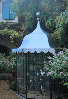 garden aviary in tent style with a tole roof