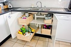 Kitchen Sink Remodel Under Kitchen Sink Storage - Under kitchen sink storage ideas for the scary cabinets under your sink. Learn how to organize the scary cabinet under your kitchen sink using sliding drawers, lazy susans, bins, and more. Under Kitchen Sink Storage, Kitchen Redo, Kitchen Organization, Kitchen Remodel, Kitchen Design, Sink Organizer, Storage Drawers, Storage Compartments, Cabinet Storage
