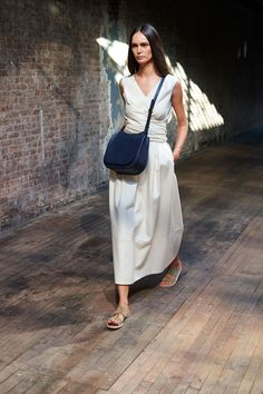 For every look that belled out like a burka, there was one that cinched the waist. Layers of fabric would be wrapped and tied like chic robes that called to mind both Asian and African traditional silhouettes.   - HarpersBAZAAR.com