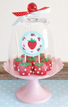 Strawberries are in season right now and the farmers' markets in NYC are chock full of them. This party, styled by Bird from Bird's Party,is perfect for a spring fling or picnic party. Sweet treats on the dessert table included strawberry cake pops, cupcakes, macarons, meringues and a pretty pink cake topped with DIY fondant …