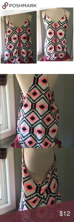 Tribal bold print top Racer back top in a bold pink and black print. Never worn. No tags .JR size XL length from underarm to him is 14 inches. Length from chest  to neck to bottom hem 16inches. Underarm to underarm 22 inches. Tops Tank Tops