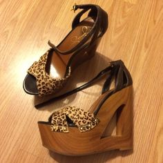 Leopard cut out wood wedge sandal These shoes by Jessica Simpson really make a statement! And they are comfy to walk in. They are in good condition. The only parts that look worn are the straps that go around the ankle and buckle. See last pic. Jessica Simpson Shoes Sandals