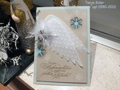 Maybe use Tim Holtz wing die with vellum?  angel wings Christmas card