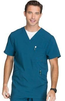 A Mens Athletic fit V-neck top features a chest pocket with grommet detail, front welt pockets with triple-needle topstitching, front and back yokes, and stretch rib knit back panels for extra comfort. Center back length: 29 Cherokee Uniforms, Cherokee Scrubs, Lab Coats, Medical Scrubs, Scrub Pants, Scrub Tops, Poplin Fabric, V Neck Tops, Blue Tops