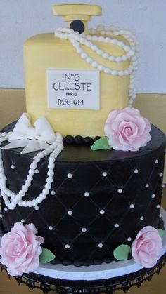 Stunning cake at a Coco Chanel birthday party! See more party planning ideas at CatchMyParty.com!