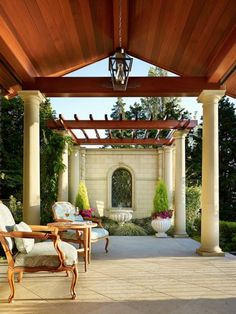 This romantic outdoor room lies just off the master bedroom of a home by Toth Construction.